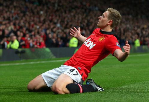 MANCHESTER, ENGLAND - MAY 06: James Wilson of Manchester United celebrates scoring the second goal during the Barclays Premier League match between Manchester United and Hull City at Old Trafford on May 6, 2014 in Manchester, England. (Photo by Alex Livesey/Getty Images)