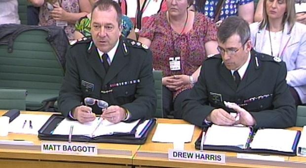 PSNI chief constable Matt Baggott (left) and Assistant Chief Constable Drew Harris give evidence in the House of Commons to the ongoing Northern Ireland Affairs Committee inquiry into the contentious on-the-run (OTR) administrative process.