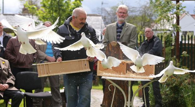 IRA murder victim Jean McConville's son Archie releases doves as the family gather to plant a tree to mark what would have been her 80th birthday at the Wave Trauma Centre in Belfast. Niall Carson/PA Wire