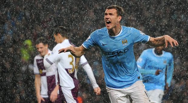 Manchester City's Edin Dzeko celebrates scoring his teams 1st goal during the Barclays Premier League match at the Etihad Stadium, Manchester.