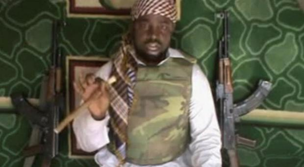 This file image made available Wednesday, Jan. 10, 2012, taken from video posted by Boko Haram sympathizers, shows the leader of the radical Islamist sect Imam Abubakar Shekau. Boko Haram has claimed responsibility for the April 15, 2014, mass abduction of nearly 300 teenage schoolgirls in northeast Nigeria