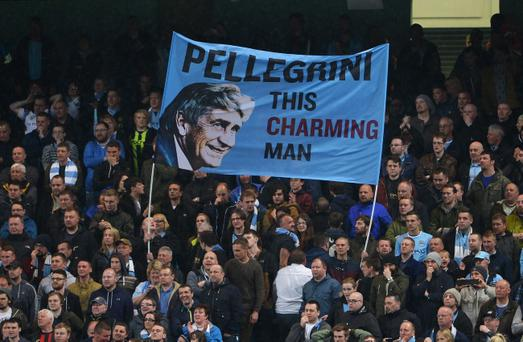 MANCHESTER, ENGLAND - MAY 07: Manchester City fans fly a flag for Manuel Pellegrini, manager of Manchester City during the Barclays Premier League match between Manchester City and Aston Villa at Etihad Stadium on May 7, 2014 in Manchester, England. (Photo by Michael Regan/Getty Images)