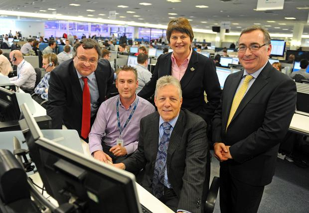 First Minister Peter Robinson, Enterprise Minister Arlene Foster and Employment Minister Dr Stephen Farry with Ed Brown (right), managing director of Capita Managed IT Solutions and Gary Coates, service desk analyst, at their offices yesterday