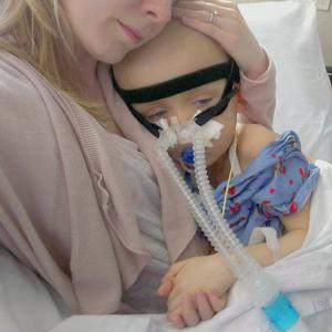 Oscar Knox being held by his mother Leona in hospital. This photo was posted by Oscar's family on October 13, 2012