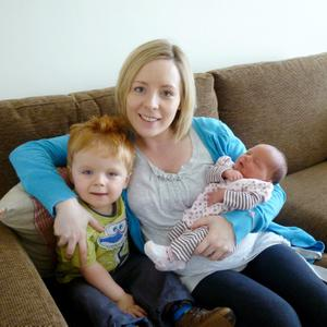 Oscar Knox pictured with mum Leona and sister Izzie