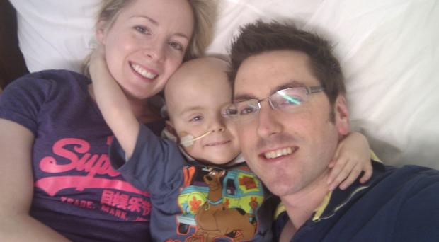 Oscar Knox pictured with mum Leona and dad Stephen