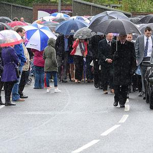 The service for little Oscar Knox was held in St Bernard's Church, Glengormley. The procession started from the NI Children's Hospice and onwards to St Bernard's Church. Picture By: Arthur Allison.