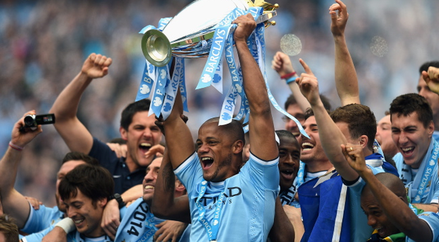 Manchester City celebrate after winning the Premier League