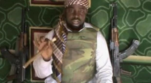 An image from a video posted by Boko Haram sympathizers shows the leader of the radical Islamist sect Imam Abubakar Shekau. Boko Haram has claimed responsibility for the April 15, 2014, mass abduction of nearly 300 teenage schoolgirls in northeast Nigeria. (AP Photo/File)