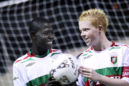 Changed times: Afriyie Acquah in his Glentoran days with the Irish League club's former under-15 captain Conor McGrattan