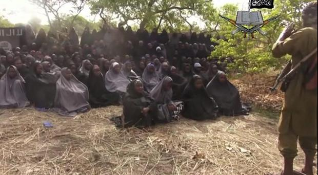 In this photo taken from video by Nigeria's Boko Haram terrorist network, Monday May 12, 2014 shows the alleged missing girls abducted from the northeastern town of Chibok
