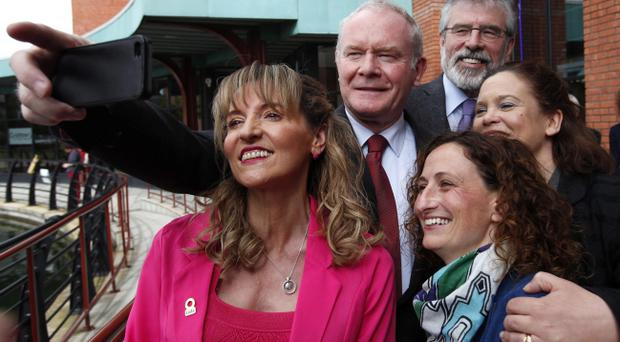 Selfie portrait: Martin McGuinness takes a snap of himself with Euro candidate Martina Anderson (front left), party president Gerry Adams, Lynn Boylan (front right) and Mary Lou McDonald during the launch of the party's manifesto for the European Parliament elections in Belfast yesterday
