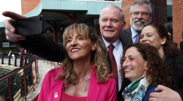 Gerry Adams poses for a selfie with Deputy First Minister Martin McGuinness, Mary Lou McDonald (right), and two of the party's Euro candidates, Martina Anderson (left) and Lynn Boylan