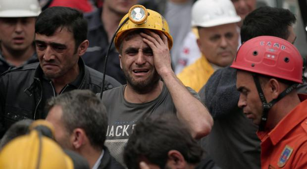 A miner cries as rescue workers carry the dead body of a miner from the mine in Soma, western Turkey, Wednesday, May 14, 2014 (AP Photo/Emrah Gurel)