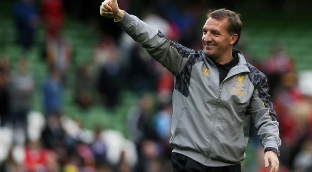 Liverpool manager Brendan Rodgers salutes the supporters after the Friendly match at the Aviva Stadium, Dublin, Ireland. PRESS ASSOCIATION Photo. Picture date: Wednesday May 14, 2014. See PA story SOCCER Shamrock. Photo credit should read: Brian Lawless/PA Wire.