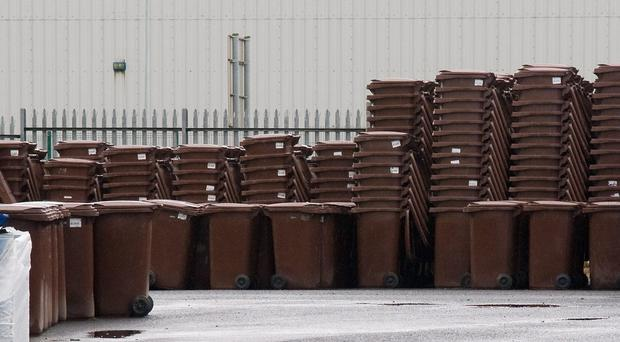 Some of the thousands of brown recycling bins which have been stockpiled by Derry City Council