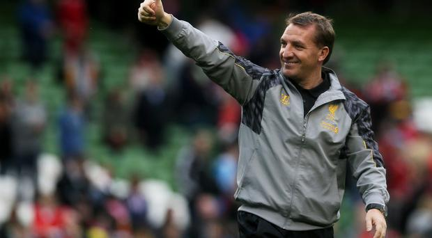 Liverpool manager Brendan Rodgers salutes the supporters after the Friendly match at the Aviva Stadium