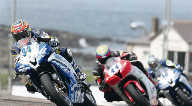 Setting the pace: Alastair Seeley takes charge in the Supersport race
