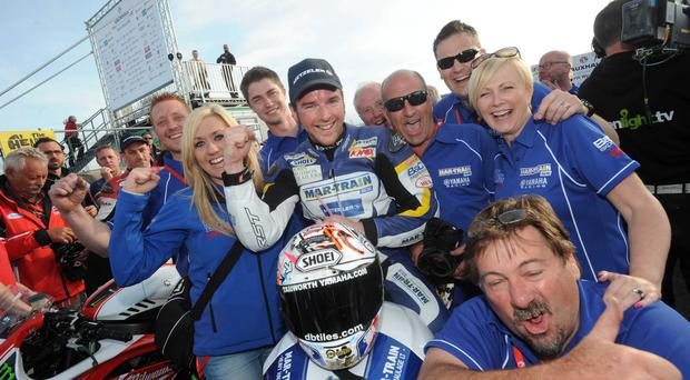 Number one: Alastair Seeley celebrates with his team after victory at the North West 200 yesterday
