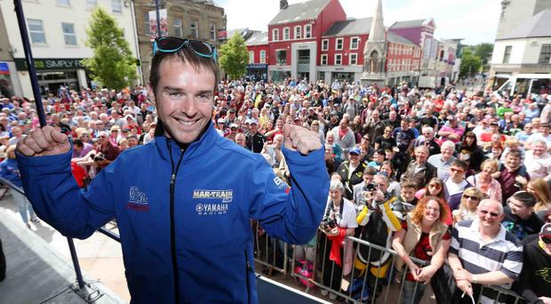 Meet and greet: Alastair Seeley salutes the fans in Coleraine town centre yesterday
