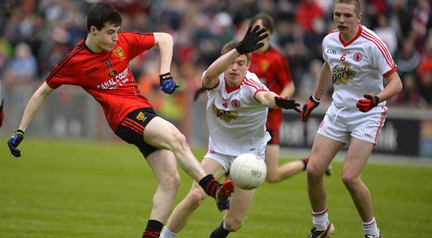 Down's James Guinness and Tyrone's Niall Kelly with Rhys Quinn in action. Pic Russell Pritchard / Presseye