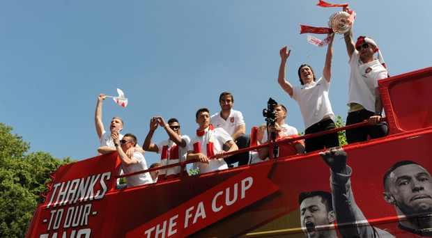 Tomas Rosicky and Jack Wilshere of Arsenal FC celebrate with the FA Cup onboard the Arsenal team bus during the Arsenal FA Cup Victory Parade in Islington, London on May 18, 2014 in London, England. (Photo by Steve Bardens/Getty Images)