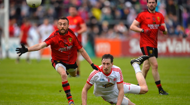 Tyrone's Colm Cavanagh and Down's Conor Laverty in action during their Sunday clash at Healy Park. Pic Russell Pritchard / Presseye