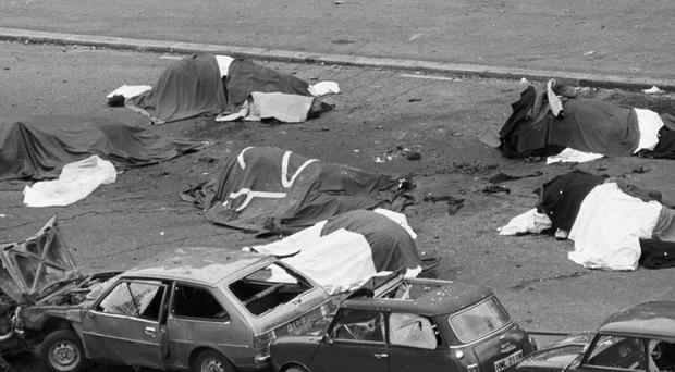 Dead horses lie in the street after the Hyde Park bombing in 1982