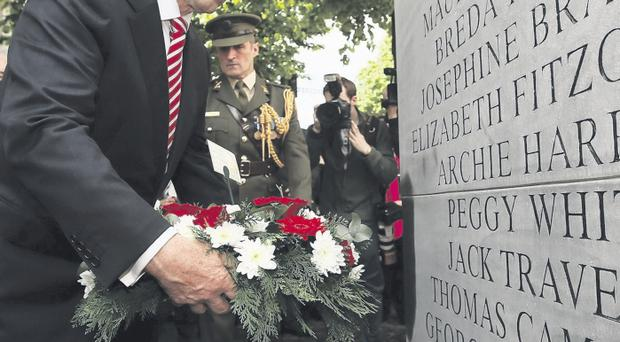 Taoiseach Enda Kenny lays a wreath in Dublin yesterday to mark the 40th anniversary of the Dublin and Monaghan bombings