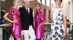 Paul Costelloe with three of his designs