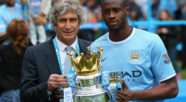 Manchester City manager Manuel Pellegrini and Yaya Toure
