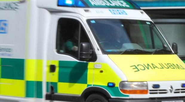 A car has smashed into an ambulance taking a patient to hospital