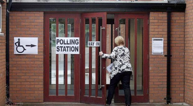 Voters pictured at Dundonald Elim Church in east Belfast casting their vote