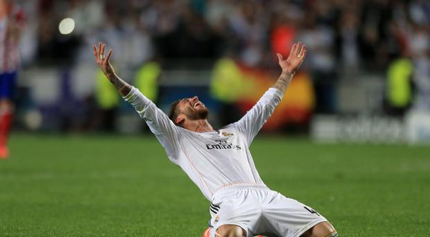 Real Madrid's Sergio Ramos celebrates during the UEFA Champions League Final at at the Estadio da Luiz, Lisbon, Portugal. PRESS ASSOCIATION Photo. Picture date: Saturday May 24, 2014. See PA story SOCCER Final. Photo credit should read: Nick Potts/PA Wire. RESTRICTIONS: Editorial use only. No commercial use. No video emulation. No false commercial association.