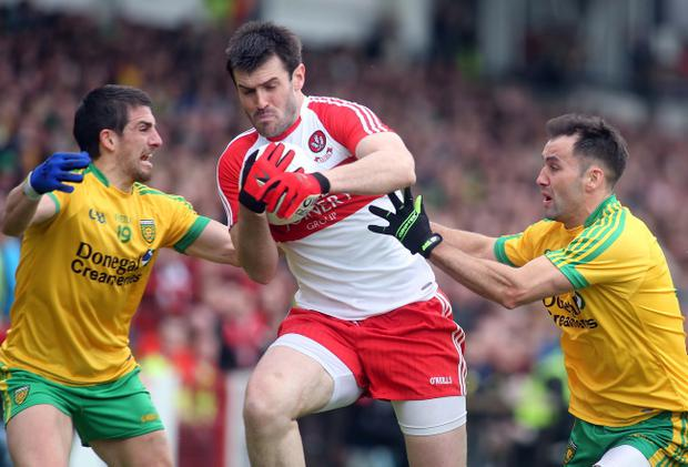 Ulster GAA Senior Football Championship. Derry V Donegal. Derry's Mark Lynch and Donegal's Paddy McGrath and Karl Lacey. Photo Lorcan Doherty Photography