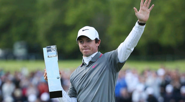 Rory McIlroy of Northern Ireland poses with the trophy following his victory (Photo by Richard Heathcote/Getty Images)