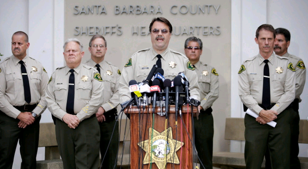 Santa Barbara County Sheriff Bill Brown, center, speaks during a news conference on Saturday, May 24, 2014, in Santa Barbara, Calif. (AP Photo/Jae C. Hong)