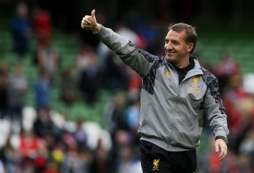 Brendan Rodgers said he was both 'humbled and privileged' to sign a new Liverpool contract until 2018. Photo: Brian Lawless/PA Wire