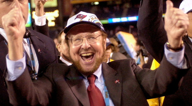 In this Jan. 26, 2003 file photo, Tampa Bay Buccaneers owner Malcolm Glazer celebrates the Bucs' 48-21 victory over the Oakland Raiders in Super Bowl XXXVII in San Diego. Glazer, the self-made billionaire who owned the NFL's Tampa Bay Buccaneers and English soccer's Manchester United, has died. (AP Photo/Dave Martin, File)