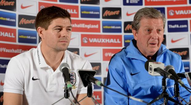 File photo dated 04/03/2014 of England manager Roy Hodgson (right) and Liverpool captain Steven Gerrard. Liverpool drew plaudits for their style of play last season and former Manchester United midfielder Paul Scholes has said England should play like them at the World Cup. Photo: Andrew Matthews/PA Wire