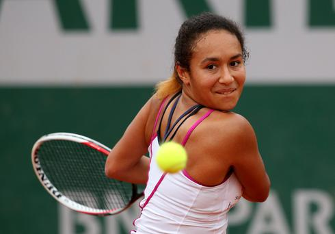 Knockout: Heather Watson loses out to Simona Halep yesterday