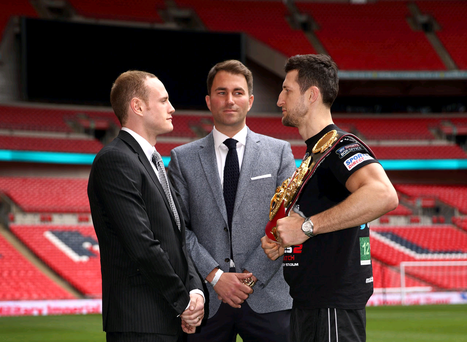 Promoter Eddie Hearn stands between Carl Froch and George Groves as they go head to head during a press conference to announce the upcoming WBA & IBF Super Middleweight World Championship fight between Carl Froch and George Groves at Wembley Stadium on May 29, 2014 in London, England. (Photo by Jordan Mansfield/Getty Images)