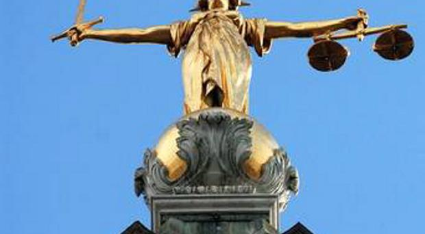 Man allegedly 'tried to choke his partner and threatened to cut her fingers off with scissors', court hears