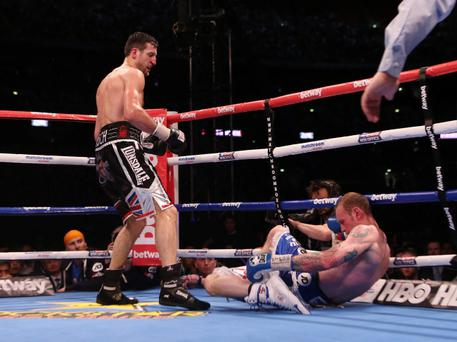 Carl Froch knocks down George Groves to win the IBF and WBA World Super Middleweight Title fight at Wembley