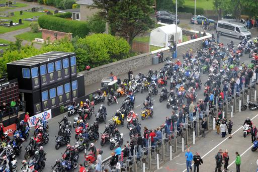 PACEMAKER BELFAST 01/06/2014: Thousands of bikers at the TT grandstand for the start of a parade lap in memory of Simon Andrews who was killed last month at the North West 200 on Mad Sunday at the 2014 Isle of Man TT