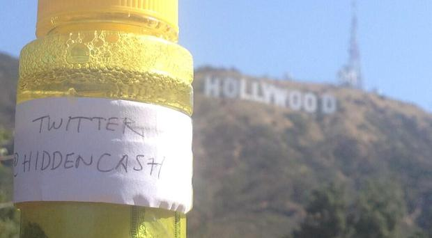 A picture posted under the @HiddenCash Twitter account showing cash inside a bottle
