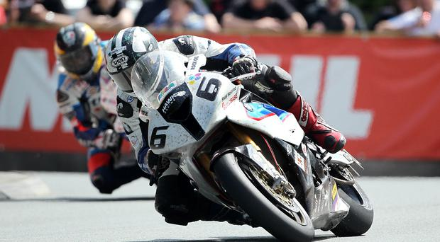 Michael Dunlop leads Guy Martin during Saturday's big race