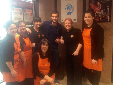 SPECIAL MOMENT: The staff at The Chippy, including manager Joanne Graham (2nd from right) posing for pictures with Jamie Dornan