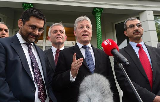Peter Robinson along with Muslim leaders outside the Islamic Centre in Belfast. Pic Arthur Allison