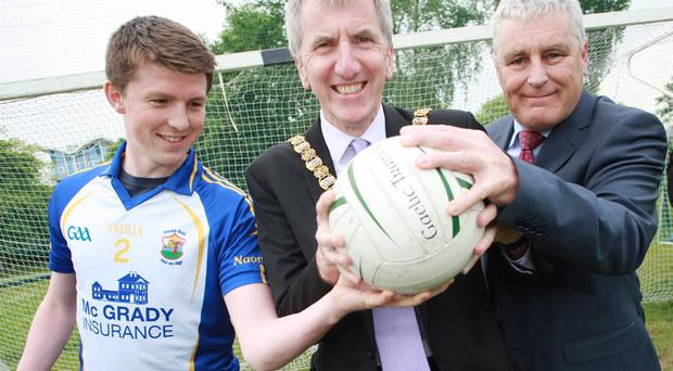 On the up: Club sponsor representative and senior footballer Ronan McGrady, McGrady Insurance, out-going Lord Mayor Máirtín Ó Muilleoir and St. Brigid's Chairman, Dermot Dowling pictured at the new Musgrave Park development